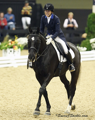 A happy Akiko Yaazaki on Matrix after their ride to victory in the US Dressage Finals Prix St. Georges adult amateur championship. ©2013 SusanJStickle.com