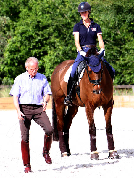 "Jürgen Koschel demonstrating a movement with Arlene ""Tuny"" Page and Woodstock. © 2013 Ken Braddick/dressage-news.com"