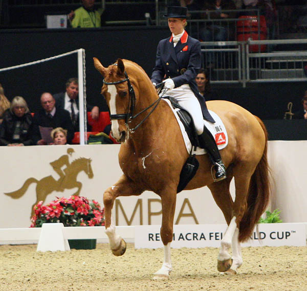 Laura Bechtolsheimer and Mistral Hojris in their fourth and final competition at London Olympia, where the pair posted their only Freestyle victory at the iconic Christmas show. © 2011 Ken Braddick/dressage-news.com