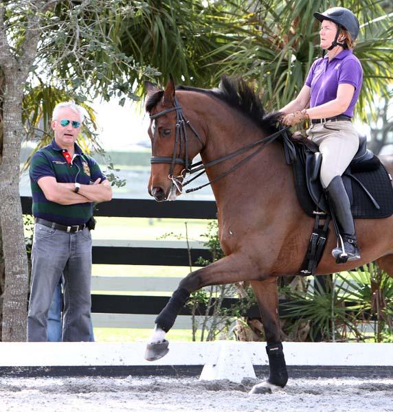 Ton de Ridder watching Ilse Schwarz riding Cadenza, her homebred Contango gelding. ©2013 Ken Braddick/dressage-news.com