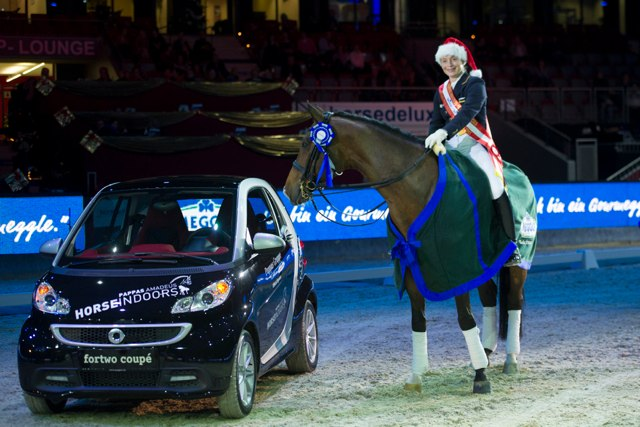El Santo eyeing the car that he and Isabell Werth received for winning the Pappas Amadeus CDI5* Freestyle in Salzburg. © 2013 Nini Schäbel