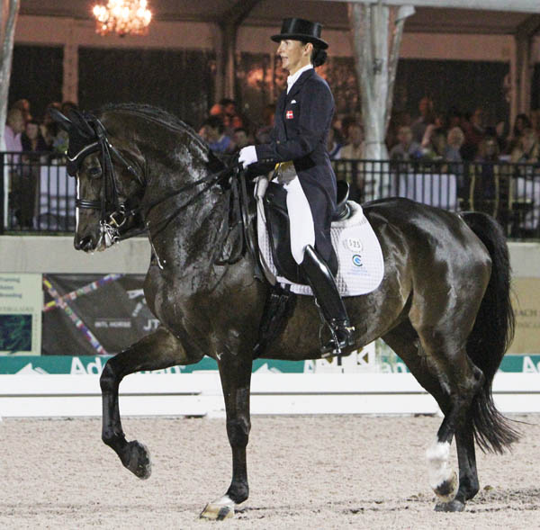 Mikala Munter Gundersen and My Lady riding to their new music at the Global Dressage Festival World Cup Freestyle. © 2014 Ken Braddick/dressage-news.com