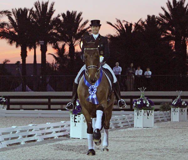 Against a backdrop of setting sun and palm trees, Tinne Vilhelmsson-Silfvén rides Divertimento in celebration of 35th victory in four years on Floida winter circuit. © 2014 Ken Braddick/dressage-news.com