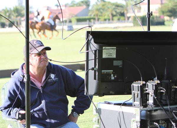 U.S. Polo Association umpire Steve Lane, monitoring the instant replay. © 2014 Ken Braddck/dressage-news.com