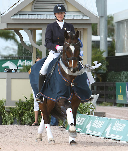 Karen Pavicic and Don Daiquiri celebrating victory in the Adequan Global Dressage Festival CDI3* Grand Prix. © 2014 Ken Braddick/dressage-news.com