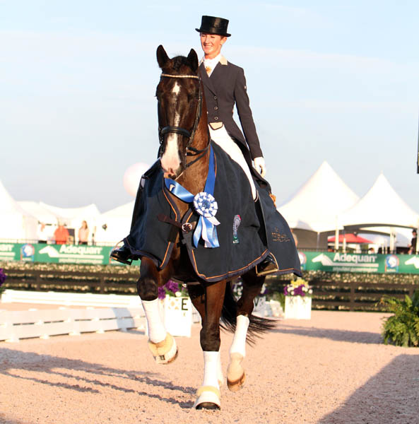 Kelly Layne of Australia on Udon P celebrating their victory in the CDI3* Grand Prix Freestyle at Florida's Global Dressage Festival. © 2014 Ken Bradick/dressage-news.ccom