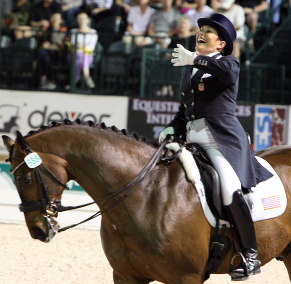 Shelly Francis on Doktor enjoying applause from the crowd at the Wellington Nations Cup Freestyle. © 2014 Ken Braddick/dressage-news.com