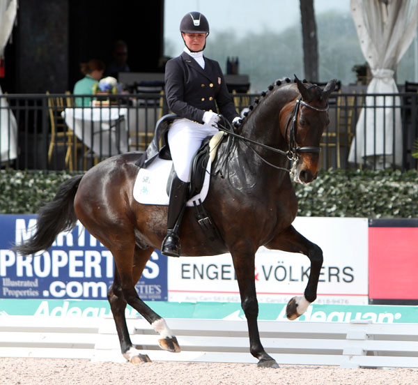 Adrienne Lyle and Wizard on their way to victory in the CDI5* Grand Prix Special with personal best score and highest from American combination in 2014. © 2-14 Ken Braddick/dressage-news.com