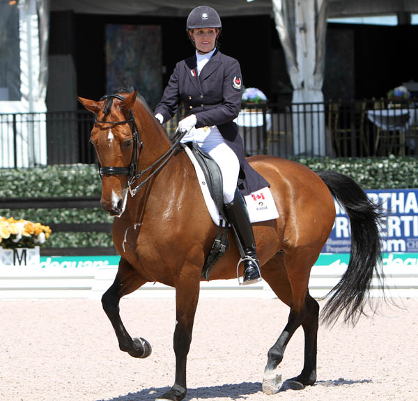 Ashley Holzer and Tiva Nana winning the Adequan Global Dressage Festival Grand Prix Special. © 2014 Ken Braddick/dressage-news.com