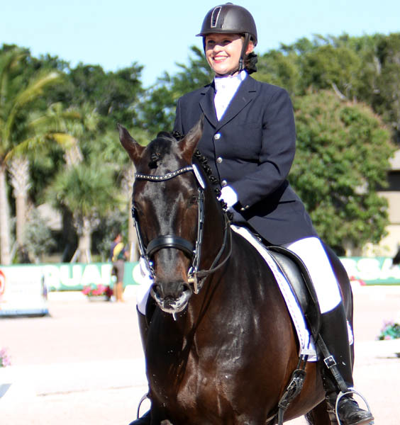 The smile on the face of Nina Jaakkola on Zimbro La Cascada says it all about competing in Wellington. © 2014 Ken Braddick/dressage-news.com