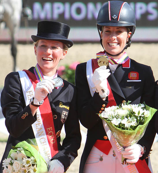 Helen Langehanenberg and Charlotte Dujardin together on a medals podium. © 2013 Ken Braddick/dressage-news.com