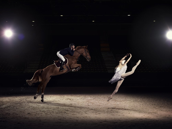 US jumping rider Charlie Jacobs demonstrates the power and athleticism of his sport, alongside Liudmila Khitrova from the Minsk Bolshoi, ahead of the Longines FEI World Cup Jumping Final in Lyon, France. © FEI/Hamish Brown