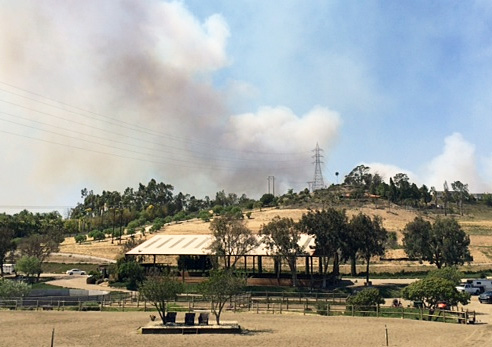 Fire behind Arroyo Del Mar, the stables of Steffen and Shannon Peters in San Diego, California. Photo: Courtesy Steffen Peters