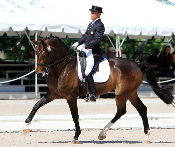 Steffem Peters and Rosamunde on their way to winning the US Championship Intermediate 1. © 2014 Ken Braddick/dressage-news.com