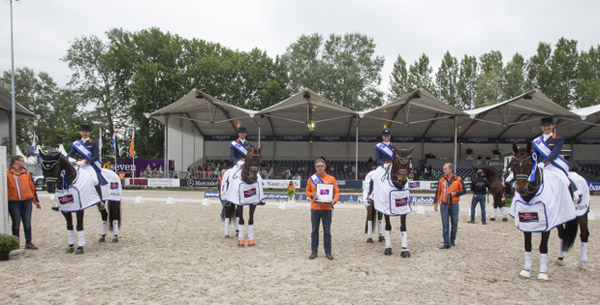 The Dutch team of (left to right) Edward Gal, Hans-Peter Minderhoud, Adelinde Cornelissen and Danielle Heijkoop. © 2014 FEI/Dirk Caremans