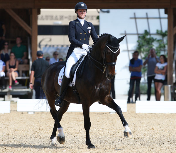 Adrienne Lye and Wizard post persoal best result In their first ever Freestyle in Europe. © 2014 Ken Braddick/dressage-news.com