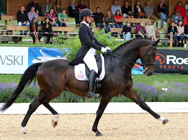 Adrienne Lyle and Wizard competing in the Grand Prix, scoring 68.640 per cent for fifth place. © 2014 Ken Braddick/dressage-news.com