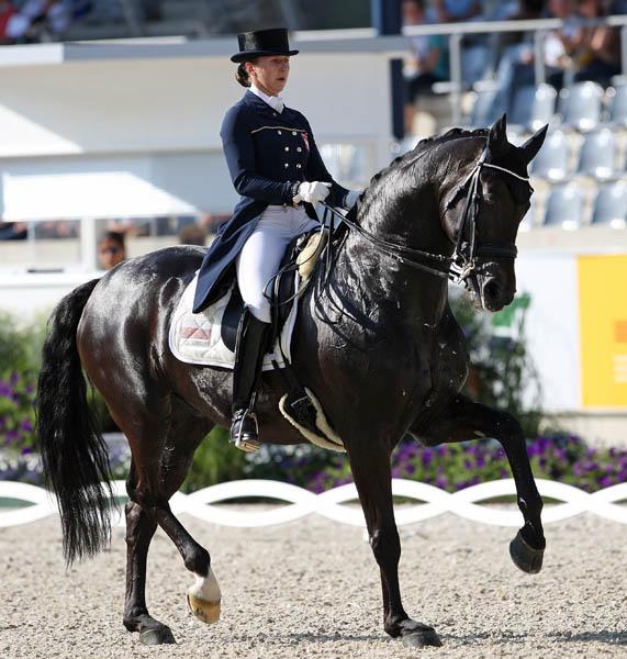 Beata Stremler riding Rbicon D to third place at the World Equeatrian Festival CDI4* Grand Prix. © 2014 Ken Braddick/dressage-news.com