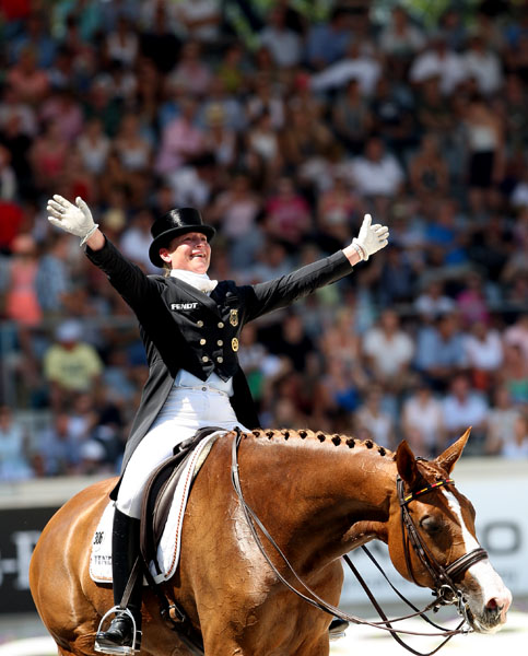 Isabell Werth on Bella Rose celebrating after the CDIO5* Grand Prix Freestyle in Aachen, Germany. © 2014 Ken Braddick/dressage-news.com