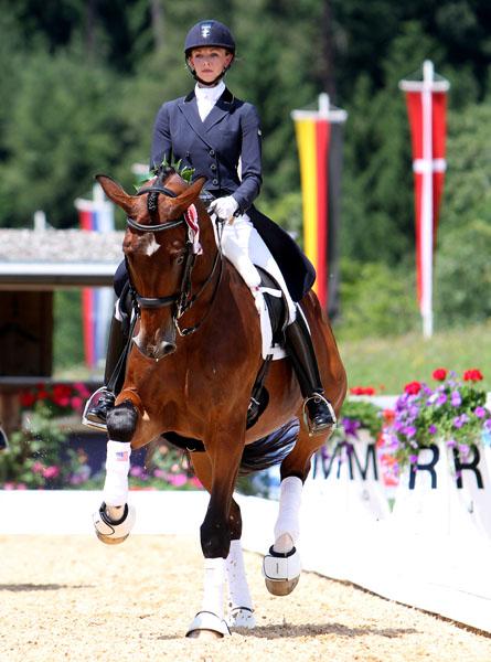 Laura Graves onVerdades celebrating success at Fritzens, Austria. © 2014 Ken Braddick/dressage-news.com