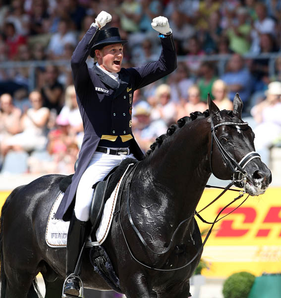 Matthias Alexander Rath on Totilas after the pair completed the Nations Cup Grand Prix ride that led Germany to victory. © 2014 Ken Braddick/dressage-news.com