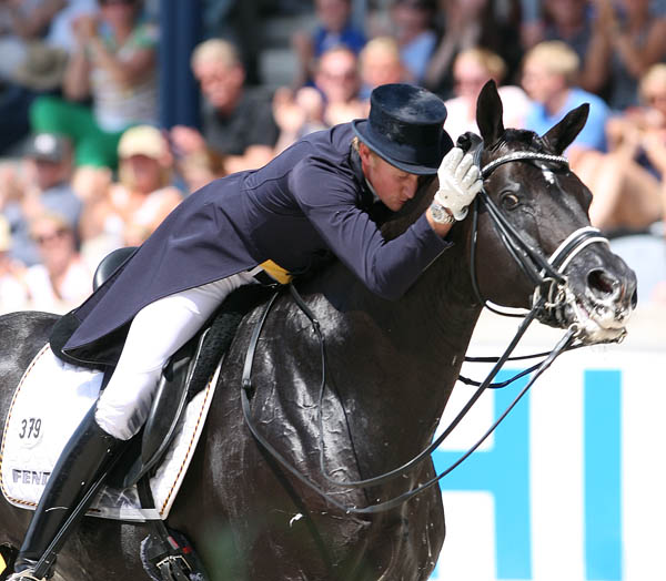 Matthias Alexander Rath hugging Totilas after their winning CDIO5* Grand Prix Special in Aachen. © 2014 Ken Braddick/dressage-news.com