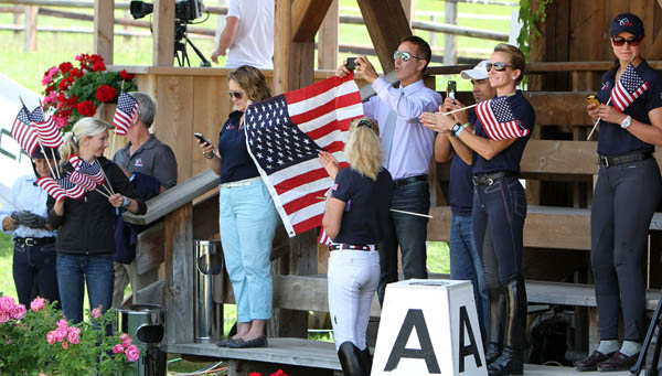 United States team members and supporters showing the Stars and Stripes to celebrate Steffen Peters' victory on Rosamunde in the Schindlhof CDI4* in the Prix St. Georges on the Fourth of July. © 2014 Ken Braddick/dressage-news.com