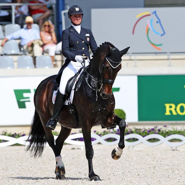 Wizard ridden by Adrienne Lyle competing in Europe. © 2014 Ken Braddck/dressage-news.com