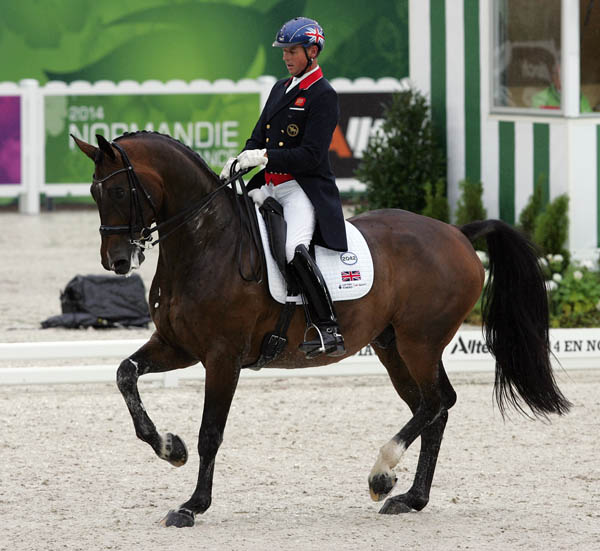 Carl Hester and Nip Tuck in the Grand Prix at the World Equestrian Games. © 2014 Ken Braddick/dressage-news.com