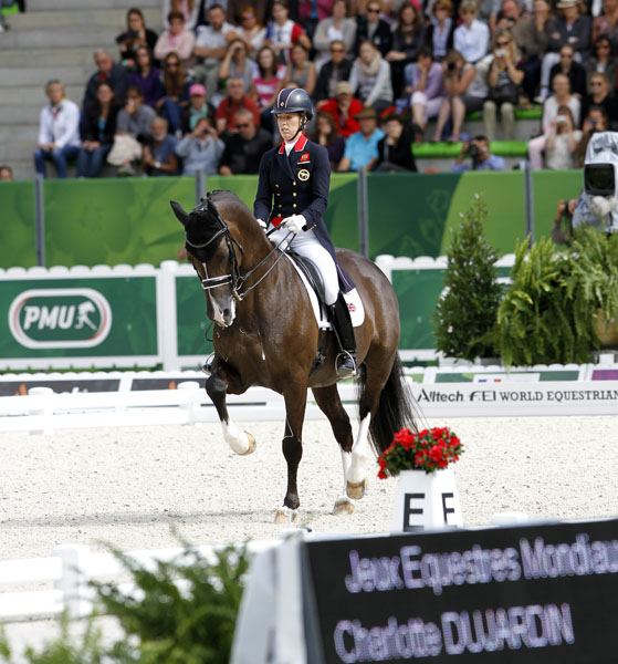 Charlotte Dujardin and Valegro in te Grand Prix Freestyle riding for their second individual gold and team silver medals at the World Equestrian Games. © 2014 Ken Braddick/dressage-news.com