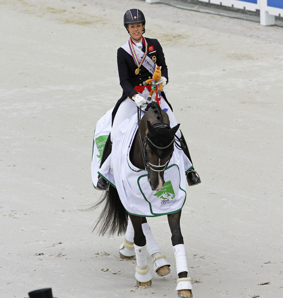 Charlotte Dujardin and Valegro in the round of honor after winning the second individual gold medal at the World Equestrian Games. © 2014 Ken Braddick/dressage-news.com