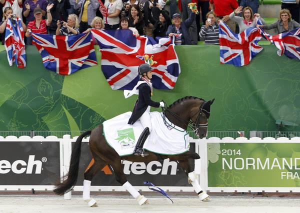 Charlotte Dujardin and Valegro enjoying gold medal honor round at the World Equestrian Games. © 2014 Ken Braddick/dressage-news.com