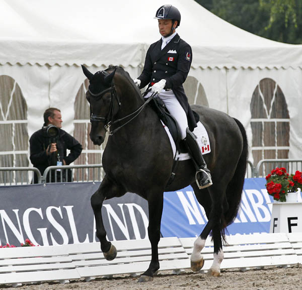 David Marcus on Chrevis Capital in the CDI3* Grand Prix at Verden, Germany. © 2014 Ken Braddick/dressage-news.com