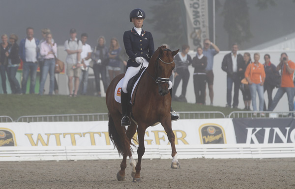 Kirsten Brouwer and Dancer Forever were first into the fog-shrouded arena for the six-year-old qualifier and placed second. © 2014 Ken Braddick/dressage-news.com