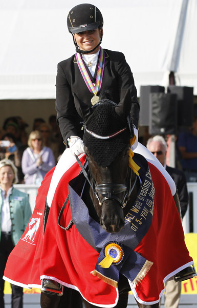 Sezuan, the 2014 five-year-old World Young Horse Campion, with Dorothee Schneider aboard. © 2014 Ken Braddick/dressage-news.com