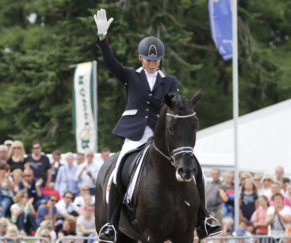 Gerdine Maree giving a triumhal salute at the end of the six-year-old world championship ride Dream Boy that won bronze. © 2014 Ken Braddick/dressage-news.com