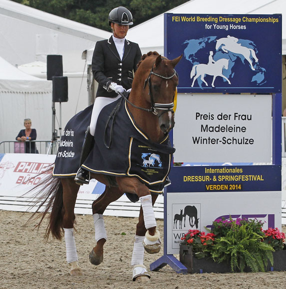 Emmelie Scholtens riding Estoril in the lap of honor fter winning the 5-year-old consolation final to be one of the top three to make it to the World Young Horse Championships. © 2014 Ken Braddick/dressage-news.com