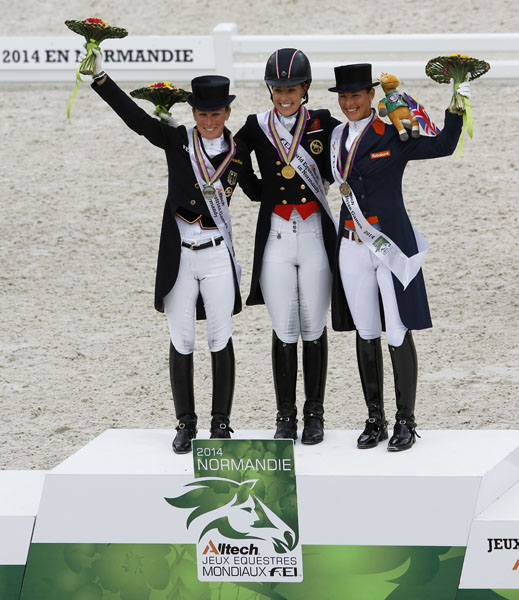 World Equestrian Games Grand Prix Freestyle medalists Chrlotte Dujardin (gold), Helen Langehnenberg (silver) and delinde Corneissen (bronze). © 2014 Ken Braddick/dressage-news.com