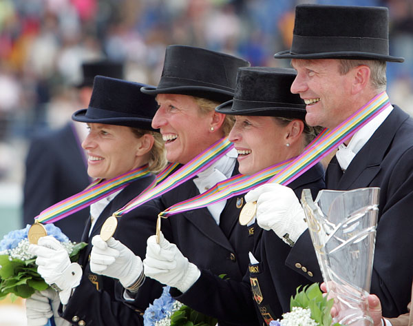 Germany's 2006 World Games gold medal team of (left to right) Nadine Capellmann, Heike Kemmer, Isabell Werth and Hubertus Schmidt. © Ken Braddick/dressage-news.com