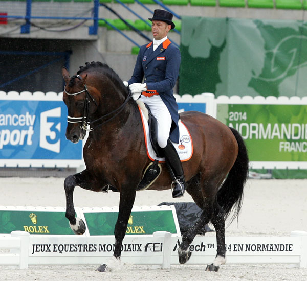 Hans Peter Minderhoud pn Glock's Johnson TN that led the Netherlands to second on the first of two days of Nations Cup Grand Prix at the World Equestrian Games. © 2014 Ken Braddick/dressage-news.com