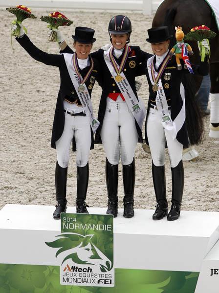 The World Equestrian Games Grand Prix Special medals podium with Charlotte Dujardin (gold), Helen Langehanenberg (silver) and Kristina Sprehe (bronze). © 2014 Ken Braddick/dressage-news.com