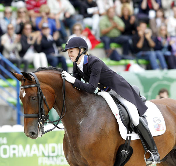 Laura Graves hugging Vardades at the World Equestrian Games. © 2014 Ken Braddick/dressage-news.com