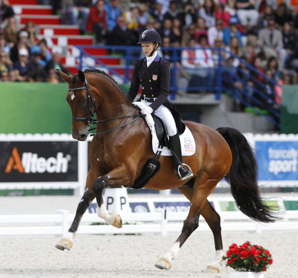 Laura Graves on Verdades in the World Equestrian Games Grand Prix Freestyle. © 2014 Ken Braddick/dressage-news.com