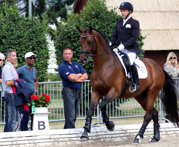 Matt Johnson and Petersborg's Qasanova being warmed up by United States Young Horse coach Scott Hassler with U.S. Chef d'Equipe Robert Dover. © 2014 Ken Braddick/dressage-news.com