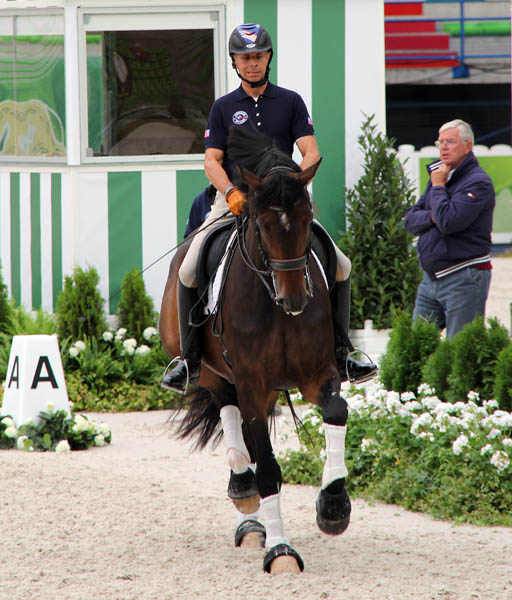 Steffen Peters on Legolas with trainer Johann Hinnemann watching. © 2014 Ken Braddick/Dressage-news.com