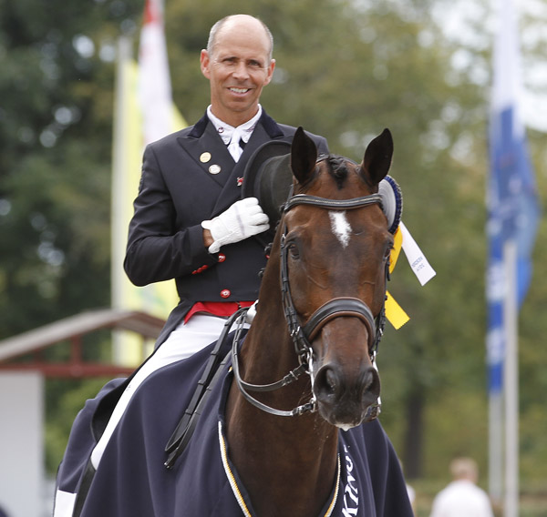 Steffen Peters on Legolas for the playing of the American national anthem for the second victory in a row. © 2014 Ken Braddick/dressage-news.com