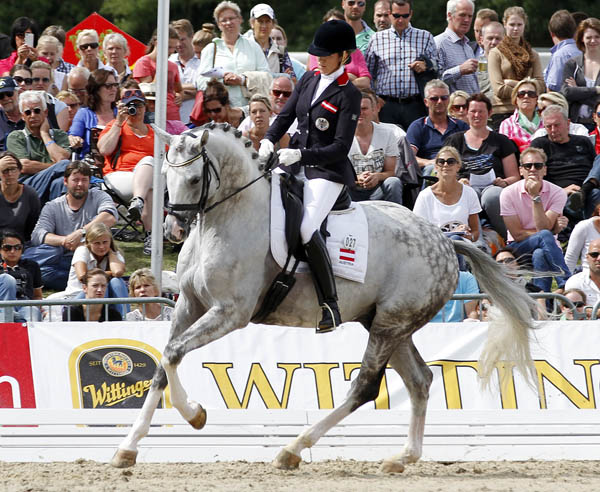Stephanie Dearing rding Auheim's Del Magico in canter that was their highest scoring gait to earn the Austrian pair the silver medal at the World Young Horse Championships. © 2014 Ken Braddick/dressage-news.com