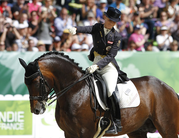 Victoria Max-Theurer on Augustin OLD giving a triumphant fist pump after the rider posted her first score above 80 per cent outside her homeland of Austria. © 2014 Ken Braddick/dressage-news.com