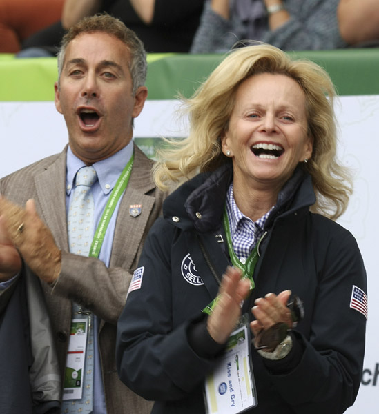 Robert Dover and Debbie McDonald applauding U.S. team at the 2014 World Games. © Ilse Schwarz/dressage-news.com