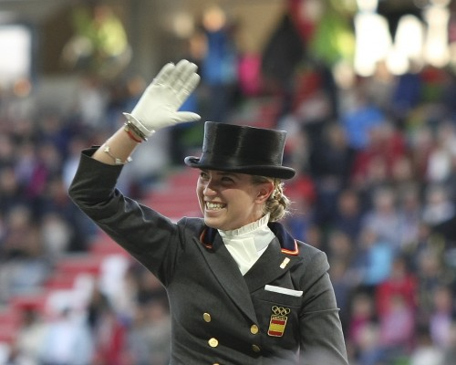An ecstatic Morgan Barbancon or Spain after her ride on Painted Black ©Ilse Schwarz dressage-news.com